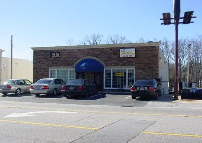 brick building exterior with blue awning